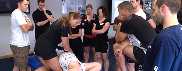 Heather Pearson teaching a group of physical therapists